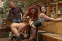 Jodi Taylor is rope bound, fucked by a huge cock, and dominated by beautiful female patrons.