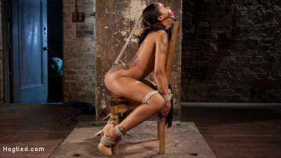 Ebony Pain Slut begs to be tormented in grueling bondage with bastinado, flogging, nipple clamps, pussy fucking, and breath play.