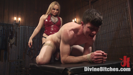 Submissive guy is locked in cock cage and takes strapon cock in his ass while mistress is topping him with her sexy butt
