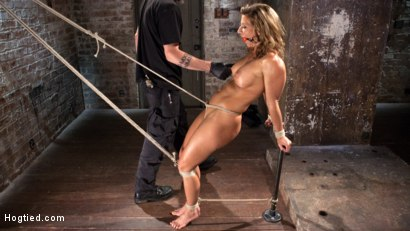 Hard bodied Queen of the mat gets captured, bound, tormented, and fucked in her pussy and ass until she squirts everywhere.