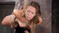 Girl next door in brutal bondage and suffering through grueling punishment makes her pussy squirt from excitement.