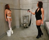 Two hookers play BDSM games in county lockup.