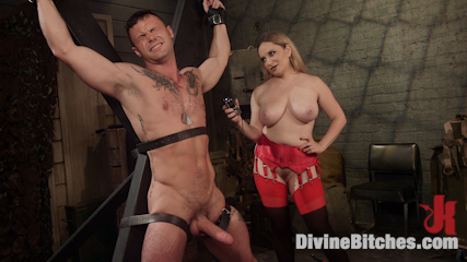 Big and strong soldier is down in the dungeon screaming and crying when busty blonde is tormenting him with cruel BDSM