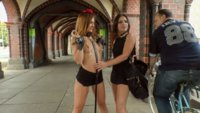 Perky young Lullu Gun is a pretty little exhibitionist whore and Julliette March gets her fully naked and crawling around on the dirty streets.