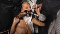 With a toilet brush strapped to her face, she has to clean a filthy urinal while getting hot cum all over her face.