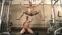 Ripped-gym-rat-Aarin-Asker-takes-a-giant-fist-while-in-suspension