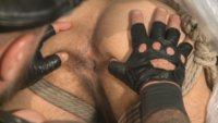 Locked in a dark dungeon, Adam gets his fill from a hung, sadistic dom.