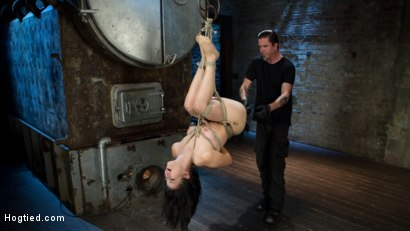 Hot brunette is trapped in tight rope bondage, made to suffer and endure orgasms against her will.