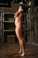 Devon Lee's double-D breasts are bound and her feet get caning