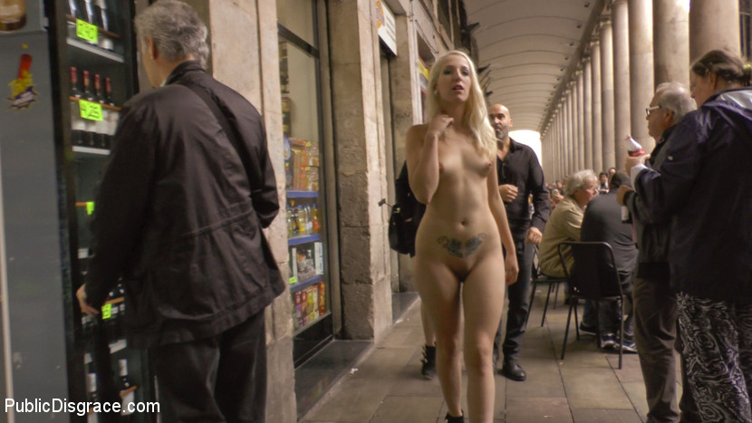 Eager blonde nympho needs all her holes publicly pounded. Mona Wales has found another loose slut that wants to be publicly humiliated. This weeks fuckhole calls herself Loose Rainbow, lets see if she can live up to her name. The first stop on our day of debauchery is a local Spanish market where Mona exposes Liz's perfectly pink perky nipples to everyone, a gang of photographers gathers around them as they fight for the perfect shot of Liz's bare uncovered kitty. Disgusted by her sluts enjoyment of her public humiliation, Mona suspends Liz Rainbows open under a bridge. Mona tag teams her piece of girl meat, publicly beating it till it is tender enough to have all of its holes used for Mona's entertainment. Gaged and blindfolded Liz Rainbow is lead into a crowded bar to gets what she has been waiting for. As she is groped by strange hands Liz closes her eyes and opens her mouth to receive as much cock as she can fit. With everyone watching Mona slides her entire hand into her Nympho's stretched meat hole. Mona punches Liz's kitty till she screams and ejaculates all over Mona's wrists. Mona then offers up her whore's holes for everyone to use. Instantly Liz Rainbow fills her anus and used up cunt with two cocks at the same time. With two gaping holes Liz Rainbows finishes off the cocks in the room by submitting her face to being used as a filthy ejaculate rag.