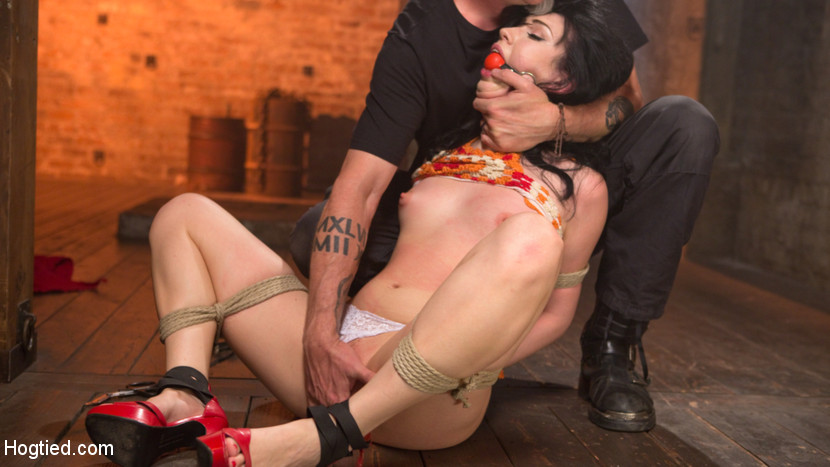 Tiny brunette is captured in bondage tortured and made to