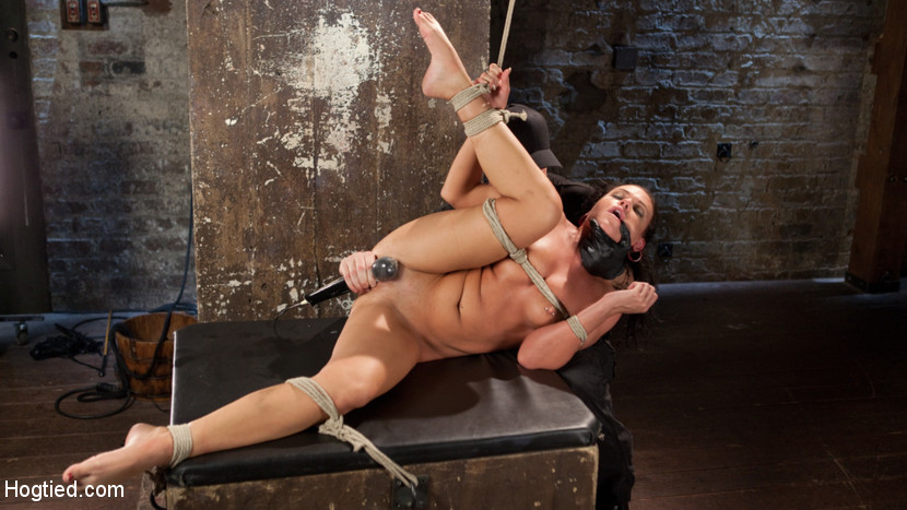 Devastating anal fisting in brutal bondage. Booty Queen, Roxy Raye loves to push her limits with how much she can shove in her bum. Today she is met with one of her biggest challenges to date; The Pope's fist. There are only seven other girls that have ever been able to take his hard fist, but this will be the first anusy fisting.She is spread eagle against a wall flogged and then a crotch rope with a bowling ball tied to it, is applied to ensure her suffering. She starts off a bit timid, but that all changes as the day goes on.Next she is in a predicament doggy position. All of her weight is balancing on one knee, her other leg is pulled in the air to expose her pussy and bum. she is tormented more and then the anusy stretching begins. We grab the biggest toy we have on set and fill her bum with it. Next we do an ankle suspension with this bitch inverted and completely helpless. She is toyed with and shocked with a zapper before she is made to cum.In the final scene Roxy is as exposed and helpless as she is going to get. This position allows the ideal angle for The Pope to shove his entire fist inside of her bum. He doesn't stop there and keeps adding more fingers in her pussy to make her as full and tight as possible. You've heard of the shocker well this is called themini van; 2 in the front and 5 in the back. You're welcome!!
