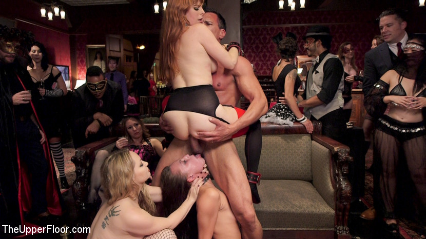 Libidinous anal slaves serve holiday orgy. At one of our liveliest shoots of the year, 200 tiny and creative sadists, masochists, swingers, and lifestyle players join the Upper Floor in a wild party celebrating hot sex and real BDSM play. The orgy is served by two returning bum slaves, Penny Pax and Audrey Holiday, who bring their slutty asses and servile knowledge to the floor in order to train the new meat girls, Goldie Rush and Aidra Fox, who are locked in a cage and swallowing cock. The senior slaves must struggle out of their bondage while being whipped, shocked, and vibrated on the sybian, then go grab a new slave and teach her the ropes. On this particular night the ropes include inhuman fucking, bum service, tight bondage, zippers, floggings, and keeping femdom Aiden Starr's pussy happy, all while collecting as many hot loads of cum as they can.