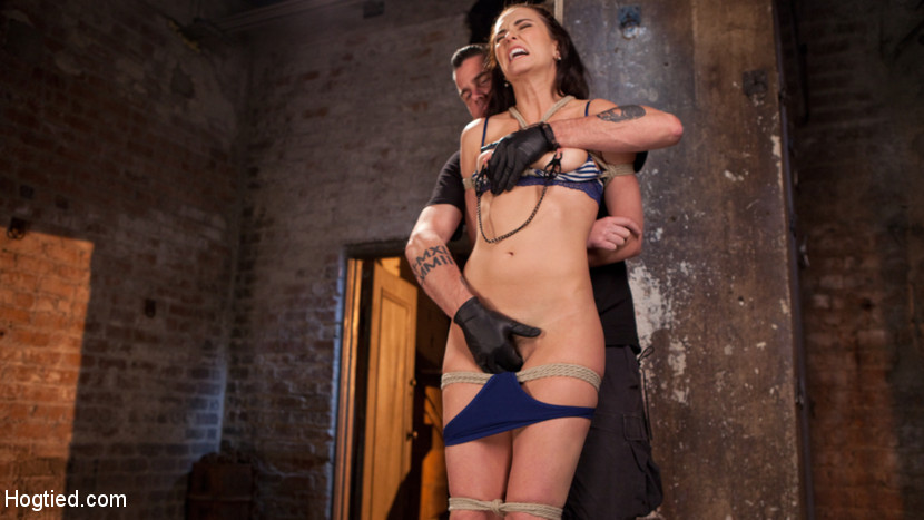 Brunette milf tortured in bondage. We begin with Bianca standing. Her head is wrapped to give her some sensory deprivation before the suffering begins. Clamps are applied to her sensitive nipples and pulled on to keep this slut screaming and then the orgasms begin. We spend the rest of the day tormenting the hell out of this slut all while tied in rope bondage. By the end of the day she has orgasmed so many times that she begs for even that to stop.