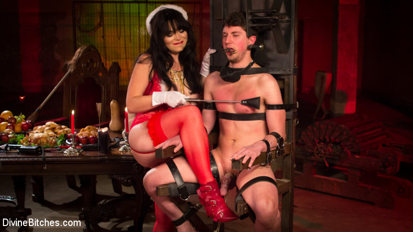 Merry bitchmas. Dominatrix Siouxsie Q James celebrates the holidays training graceful Bitches newest young slave, Grayson. How kind of her to dedicate her time and labor to guide this young piece of boy meat. Grayson will leave a better man because of it but not until Siouxsie gets paid handsomely. Siouxsie looks pleasant as pie but she is wickedly sadistic and dishes it out to Grayson with CBT, electricity, spanking and strict bondage. Grayson is pushed to the edge of orgasm with her dick pressing violent on his prostate. She even demands he have intercourse her to orgasm but he loses his load within 10 pumps in her sweet pussy. But, don't worry she gets her's and he's left to clean all the sticky mess left behind. Merry Bitchmas!