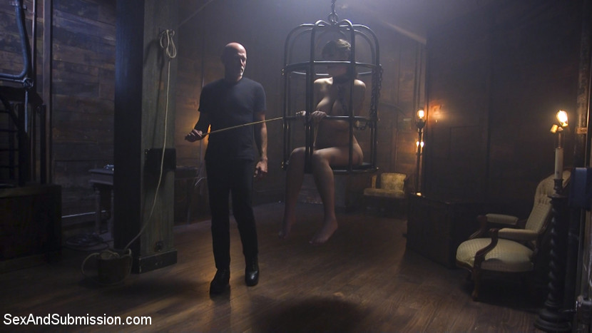The submission of charlotte cross. When Charlotte Cross' Master leaves her at the Armory to be corrected for her mistakes, Mark Davis sets the wayward slave girl right.This update includes caged slave girl, large clamps on her vagina and tits, gagging on cock, hardcore fuck in tight bondage, sexual domination and humiliation.