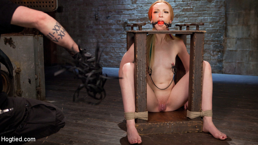Brand new red head in brutal bondage suffering and made to