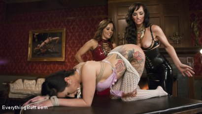 Bianca's ass is opened wide with the speculum and we see deep down inside. Both girls are fucked deep with a snake cock