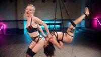 Mona Wales dominates Annie Cruz with suspension bondage, zapping, the violet wand and pussy and anal strapon fucking!