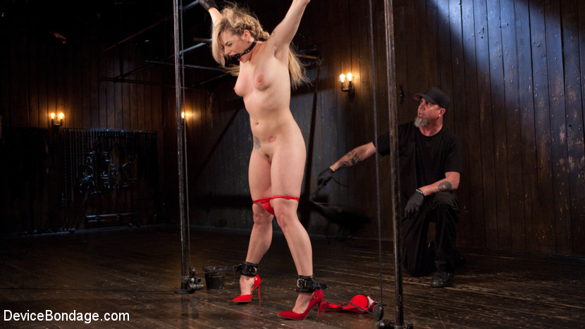 Libidinous blonde whore is brutalized in grueling bondage.