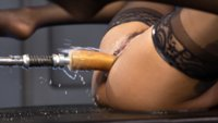 Ebony, hard-bodied queen squirts all over fast fucking machines!