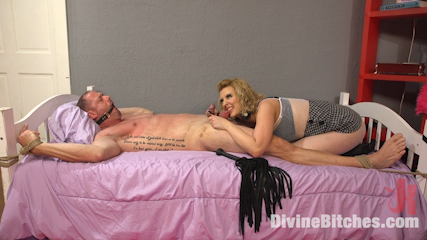 Girl is performing slow cock and balls torture before starting the femdom anal strap-on penetration
