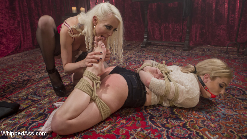 Blonde bombshell bound slap and butt fisted. Porn editor Dahlia Sky falls asleep at her computer while editing a kinky sapphic porno starring femdom Lorelei Lee. Dahlia wakes up in a dream fantasy filled with bondage, spanking, face sitting, finger banging, cunt and arse strap-on fucking, and an intense arse fisting!