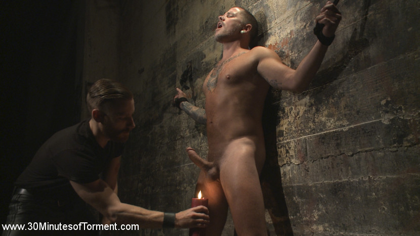 The destruction of max cameron. THE WALL - Chains hold Max against a wall while elegant hands grip his balls, and batter his body. The open hand corporal is only the start of the tortured to come. Max has yet to feel the hot wax about to coat his skin.THE PIT - Max is bound to two wooden pillars and mercilessly flogged. The intense flogging sends Max bent over in agony, leaving his bum open and ready for a visit from the fucksaw. THE WATER STATION - Max stands against a stone pillar, ready for more tortured. First he feels the inhuman intensity of the cane smacking against his body, before clover clamps clasp over his balls and nipples. All of it is foreplay leading up to the raw power from the blast of high pressure water that crashes against him. The water blast leaves him demolished, with just enough strength left to gulp his load.