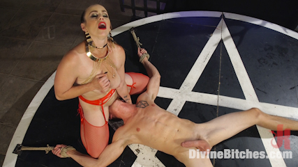 Gorgeous domme is worshipping the devil of femdom and getting ready to sacrifice a male slave in bizarre BDSM ritual