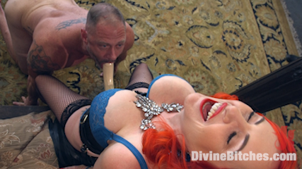 Redhead MILF clamping cock and balls with wooden pegs and then banging slave's ass laughing