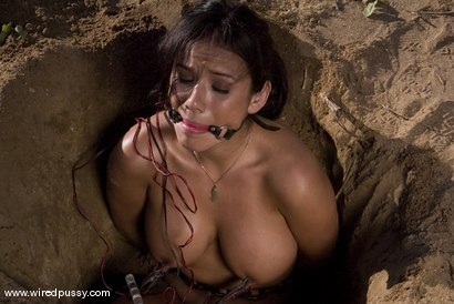 Nadia Styles is made to dig a hole while mercilessly shocked