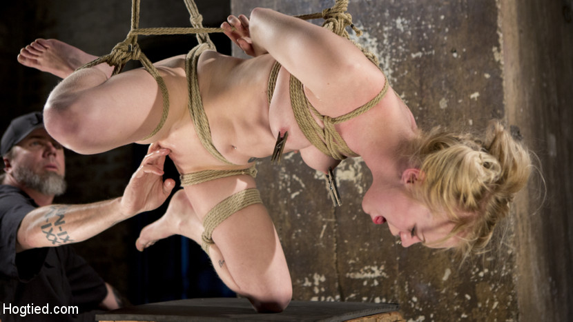 Suspension bitch anna tyler succumbs to squirting orgasms. The elegant delicate blonde Anna Tyler, dressed in little black dress and high heels is ready to surrender to her rope bondage desires. Bound and gagged, she struggles to hold back squirting orgasms as a sadistic hitachi is pushed into her tight dripping wet tiny pussy. Fully suspended, rope slicing her slit open, she screams to suffer for corporal punishment. Clothespins stinging her nipples and pinching her tongue, she is unable to resist the inhuman pleasure. Finally a penish on a stick is thrust down her throat and opens up her pussy for more orgasms.