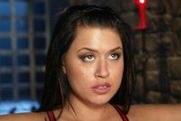 Busty beauty in lesbian fetish BDSM scene.