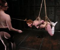 Girl endures pain in bondage and strapon fucked.