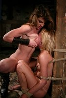 Lesbian BDSM with punishment and strapon sex.