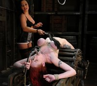 Big tit redhead in lesbian domination and bondage.