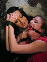Girl dominated by lesbian in bondage