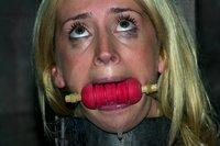 Kelly Wells and Alexa Lynn suffer in severe punishment bondage.