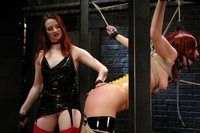 Exotic girl in latex bondage lesbian domination