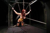 Exotic girl in latex bondage lesbian domination