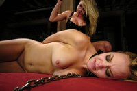 Two sexy blondes in lesbian BDSM with latex.