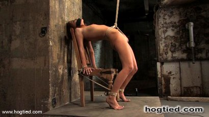 Smokin-hot-Smokie-Flame-is-back-on-Hogtied-and-she-brought-her-tight-hard-shaved-body-with-her