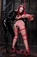 Extreme lesbian BDSM with latex.
