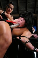 Lesbian BDSM with strap-on and ass licking.