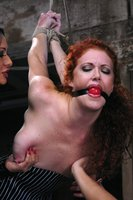 Redhead dominated by multiple women.
