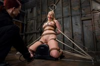 Hollie Stevens dominated by a cruel female bondage master.
