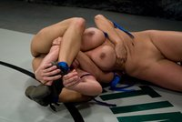 Sexy, hot, shaven MILF gets her ass kicked by a younger wrestler.