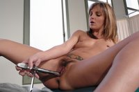 Naughty blonde gets a machine pussy and ass stretching, squirts.