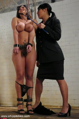 busty woman in prison with lesbian officer.