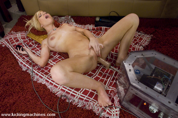 Blonde newcomer with natural tits gets pussy fucked by machines.
